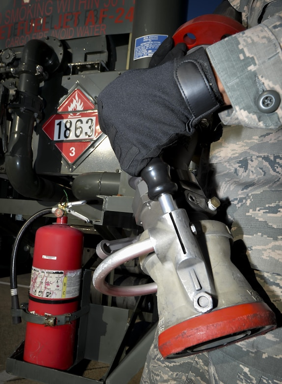 Airman 1st Class Ivan Saldivar, 2nd Logistics Readiness Squadron fuel distribution operator, holds a fuel nozzle from an R-12 hydrant servicing truck at Barksdale Air Force Base, La., Jan. 11, 2016. Fuel nozzles assist with delivering up to 600 gallons of fuel per minute to aircraft and emergency response vehicles. (U.S. Air Force photo/Airman 1st Class Mozer O. Da Cunha)