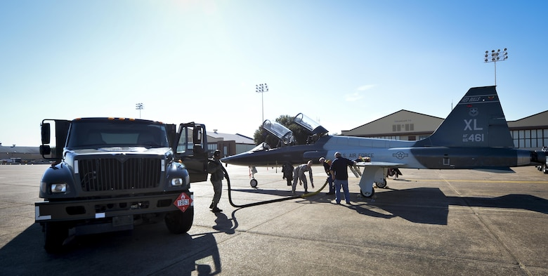 Airmen assigned to the 2nd Logistics Rediness Squadron petroleum, oils and lubricants distribution flight fuel a visiting T-38 Talon at Barksdale Air Force Base, La., Jan. 12, 2016. Distribution flight Airmen are trained to provide fuel to a variery of different aircraft. (U.S. Air Force photo/Airman 1st Class Mozer O. Da Cunha)