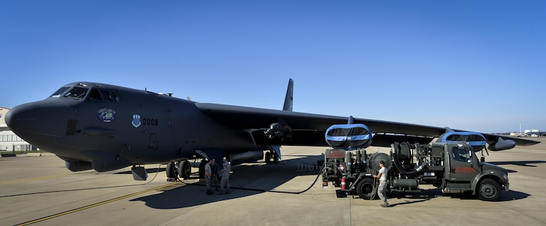Airmen assigned to the 2nd Logistics Readiness Squadron petroleum, oils and lubricants distribution flight fuel a B-52 Stratofortress at Barksdale Air Force Base, La., Jan. 12, 2016. The distribution flight uses 22 vehicles to move an average of 600,000 gallons of fuel per week. (U.S. Air Force photo/Airman 1st Class Mozer O. Da Cunha)