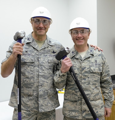 Col. Stephen Kravitsky, 90th Missile Wing commander, and Col. Hans Ritschard, 90th Medical Group commander, pose with safety gear and sledgehammers prior to a wall-breaking ceremony in the 90th MDG Medical Treatment Facility Jan. 19, 2015, on F.E. Warren Air Force Base, Wyo. The ceremony brought Airmen and community partners together to celebrate the upcoming construction project, which will rearrange the MTF's layout. (U.S. Air Force photo by Airman 1st Class Malcolm Mayfield)