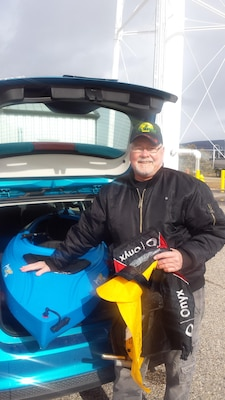 COCHITI LAKE, N.M. -- Ned Lundquist poses with his life jacket and kayak after his experience on the lake.