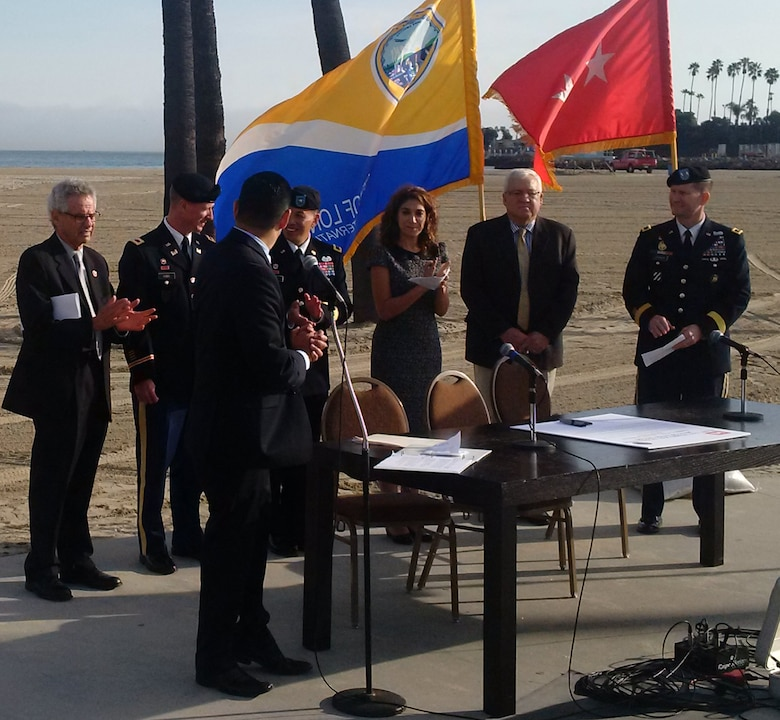 Mayor Robert Garcia, City of Long Beach; U.S. Congressman Alan Lowenthal of Long Beach; Col. Kirk Gibbs, Los Angeles District Commander, U.S. Army Corps of Engineers; Brig. Gen. Mark Toy, South Pacific Division Commander, U.S. Army Corps of Engineers; Councilwoman Suzie Price, City of Long Beach; Steven L. Stockton Director of Civil Works, U.S. Army Corps of Engineers; and Maj. Gen. Ed Jackson, U.S. Army Corps of Engineers Deputy Commanding General for Civil and Emergency Operations speak at a ceremony celebrating the signing of shared cost study for the ecological restoration of the East San Pedro Bay.
