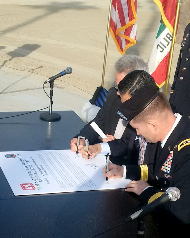 U.S. Congressman Alan Lowenthal of Long Beach; Mayor Robert Garcia, City of Long Beach and Maj. Gen. Ed Jackson, U.S. Army Corps of Engineers Deputy Commanding General for Civil and Emergency Operations sign a ceremonial document for the shared cost for the East San Pedro Bay ecological restoration study.