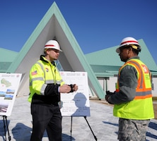 """In this photo, Chaplain (Col.) Raymond A. Robinson, Jr., the USFK command chaplain (right), receives a briefing on the recently completed chapel #1 from David M. Talbot, resident engineer of the Far East District's Family Housing Resident Office at Camp Humphreys (left).  One critical aspect of any military installation is a space that allows for service members to exercise their freedom of religion. For a military city, greater numbers and diversity demand more than just a single space. The first of four new chapels was recently completed, and is slated to be put into use by mid-2016. Until around 2014, U.S. Army Garrison-Humphreys personnel exercised their freedom of religion using one small chapel (the Freedom Chapel) and a small worship space in the 501st Military Intelligence area, said Robinson. Since the Freedom Chapel was demolished, the chaplains have been holding services in the Humphreys high school through a facility usage agreement with the Department of Defense Education Activity.  """"Many of us in the Far East District have been personally invested in the construction of these chapels, and we're going to be just as excited as the rest of the Chapel community to see this and our other new chapels open up,"""" said Talbot."""