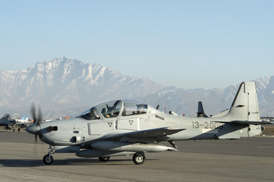 An A-29 Super Tucano taxis across the airfield at Hamid Karzai International Airport, Afghanistan, Jan. 15, 2016. The aircraft will be added to the Afghans' inventory in the spring of 2016. The A-29 Super Tucano is a 'light air support' aircraft capable of conducting close air support, aerial escort, armed overwatch and aerial interdiction. Designed to operate in high temperature and in extremely rugged terrain, the A-29 Super Tucano is highly maneuverable 4th generation weapons system capable of delivering precision guided munitions. It can fly at low speeds and low altitudes, is easy to fly, and provides exceptionally accurate weapons delivery. It is currently in service with 10 different air forces around the world. (U.S. Air Force photo by Tech. Sgt. Nathan Lipscomb)