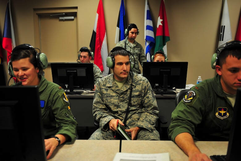 Technical Sgt. Jonathon Dennis, 337th Air Control Squadron instructor weapons director, instructs two students of the Air Battle Manager undergraduate course at the 337th ACS, Jan. 15. Dennis is responsible for instructing ABMs on a variety of missions to facilitate the Air Education and Training Command syllabus; some of these missions include simulated air to ground, large force employment simulations as well as live mission scenarios.  Ultimately, teaching the students to prioritize weapons, sensors and fuel, to meet the commander's intent and acceptable level of risk. (U.S. Air Force Photo by Senior Airman Dustin Mullen/Released)