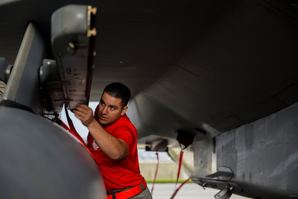U.S. Air Force Senior Airman Adan Lopez, 67th Aircraft Maintenance Unit weapons load crew chief, inspects an F-15 Eagle before loading munitions during a weapons load competition Jan. 8, 2016, at Kadena Air Base, Japan. The weapons load competition was for the first quarter of 2016 against the 44th Fighter Squadron with the winner gaining bragging rights. (U.S. Air Force photo by Senior Airman Stephen G. Eigel)