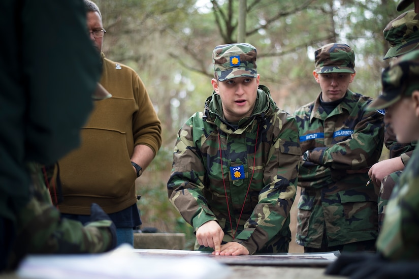 Senior Maj. Barry Feinstein, Civil Air Patrol, instructs a class of CAP cadets and seniors on land navigation techniques during a field training exercise Jan. 9, 2016, on James Island, S.C. Perhaps best known for their search-and-rescue efforts, CAP flies more than 85 percent of all federal inland search-and-rescue missions directed by the Air Force Rescue Coordination Center. (U.S. Air Force photo/Senior Airman Clayton Cupit)