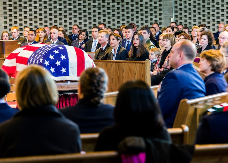 Mourners reflect during the funeral service at the Fort Myer, Va., Memorial Chapel Jan. 19 for Air Force Office of Special Investigations Special Agent (Maj.) Adrianna M. Vorderbruggen who was one of six Airmen killed by a suicide bomber near Bagram Air Base, Afghanistan, Dec. 21, 2015. (U. S. Air Force photo/Michael Hastings)