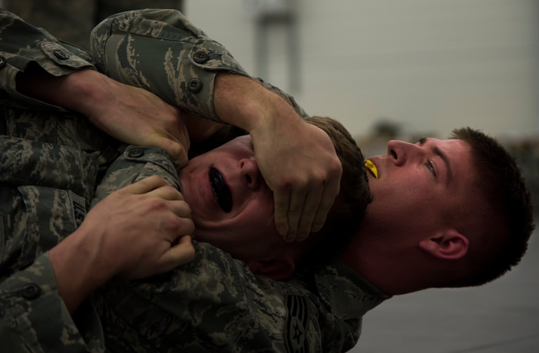 Staff Sgt. Mark Kegel, 435th Security Forces Squadron patrolman, spars with Staff Sgt. Jacob Udell, 65th SFS flight chief from Lajes Field, Portugal, during a Security Forces combative course Jan. 14, 2016, at Ramstein Air Base, Germany. Though the course is held at Ramstein, geographically separated units can send a member to be trained as an instructor and spread that knowledge upon their return to their home station. (U.S. Air Force photo/Senior Airman Jonathan Stefanko)