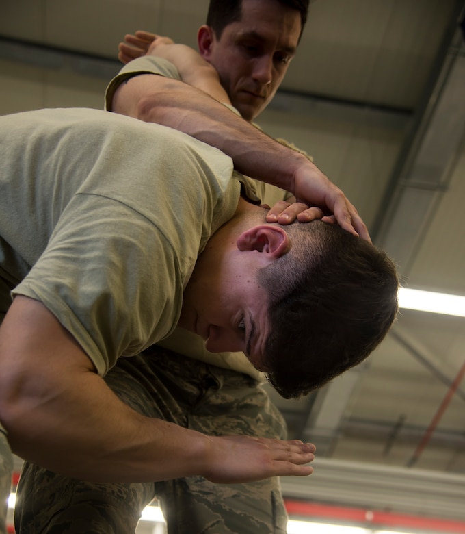 Staff Sgt. Justin Hains and Staff Sgt. Jose Ruiz, both patrolmen with the 435th Security Forces Squadron, practice self-defense maneuvers during a Security Forces combative course Jan. 14, 2016, at Ramstein Air Base, Germany. The course is designed to help defenders gain the skills, knowledge and confidence they need in order to protect and serve. (U.S. Air Force photo/Senior Airman Jonathan Stefanko)