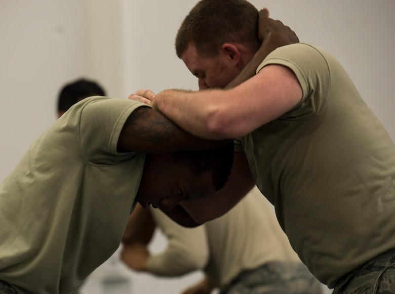 Senior Airman Michael Kurtz, 52nd Security Forces Squadron patrolman from Spangdahlem Air Base, Germany, and Airman 1st Class Nakealius Ards, 65th SFS patrolman from Lajes Field, Portugal, practice self-defense maneuvers during a Security Forces combative course Jan. 14, 2016, at Ramstein Air Base, Germany. The course is designed to help defenders gain the skills, knowledge and confidence they need in order to protect and serve. (U.S. Air Force photo/Senior Airman Jonathan Stefanko)