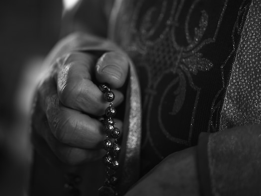 U.S. Air Force Chaplain, Maj. Mitchell Zygadlo, 501st Combat Support Wing Roman Catholic chaplain, prays with his Rosary inside the chapel on RAF Alconbury, United Kingdom, Dec. 8, 2015. From his humble beginnings as a boy growing up in Poland, Zygadlo said faith was always a strong cornerstone of his spiritual resiliency. (U.S. Air Force photo by Tech. Sgt. Jarad A. Denton/Released)