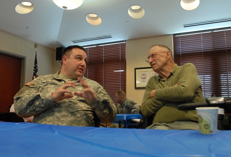 Sgt. Zach Mott, public affairs specialist with the U.S. Army Reserve's 207th Public Affairs Detachment, swaps stories with a U.S. Army veteran during a visit to the Colorado State Veterans Home at Fitzsimmons, Jan. 9. Mott and the other Soldiers of the 207th PAD ate lunch and visited with the veterans who reside in the Veterans Home.