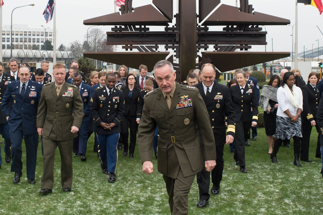 U.S. Marine Corps Gen. Joseph F. Dunford Jr., chairman of the Joint Chiefs of Staff, walks with service members and civilians at NATO headquarters in Brussels, Jan. 20, 2016. Dunford is in Brussels to attend a NATO Military Committee chiefs of staff meeting. DoD photo by D. Myles Cullen