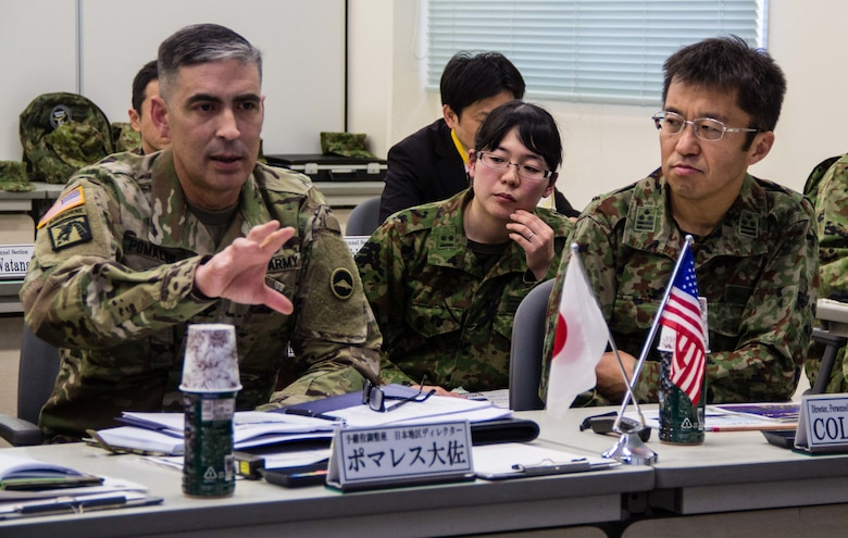 U.S. Army Col. Luis Pomales (left), a San Juan, Puerto Rico, native serving as the director of the Army Reserve Engagement Team-Japan (ARET-J), explains the U.S. Army Reserve's structure, missions and capabilities to Japan Ground Self-Defense Force Reserve Component service members during a command briefing conducted at JGSDF Western Army's headquarters in Camp Kenjun, Japan, Jan. 15, 2016. The meeting was one of several cultural, social and military training engagements designed to enhance the bilateral partnership between ARET-J and the JGSDF Western Army's Reserve Component. (U.S. Army photo by Sgt. John L. Carkeet IV, U.S. Army Japan)