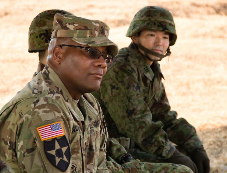 U.S. Army Sgt. Maj. Bennie B. Nunnally (right), an Atlanta native serving as the senior enlisted adviser, ARET-J, listens to a briefing conducted by senior leaders from the 8th Artillery Regiment, Western Army, Japan Ground Self-Defense Force (JGSDF). Nunnally and ARET-J's director, Army Col. Luis Pomales, traveled to Kumamoto to meet their JGSDF Western Army counterparts and discuss ideas on how to enhance the effectiveness of their respective organizations through frequent and extensive bilateral engagements. (U.S. Army photo by Sgt. John L. Carkeet IV, U.S. Army Japan)