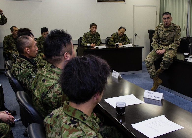 During a round table discussion conducted Jan. 16, 2016, at Camp Kenjun, Japan, U.S. Army Col. Luis Pomales (left), a San Juan, Puerto Rico, native serving as the director of the Army Reserve Engagement Team-Japan (ARET-J), discusses methods to build closer relations between Japan Ground Self Defense Force (JGSDF) Reserve Component service members and their respective civilian employers. The candid meeting was one of several social, cultural and military training events that culminated into one of the first bilateral engagements conducted exclusively by ARET-J and JGSDF Western Army Reserve Component (U.S. Army photo by Sgt. John L. Carkeet IV, U.S. Army Japan)