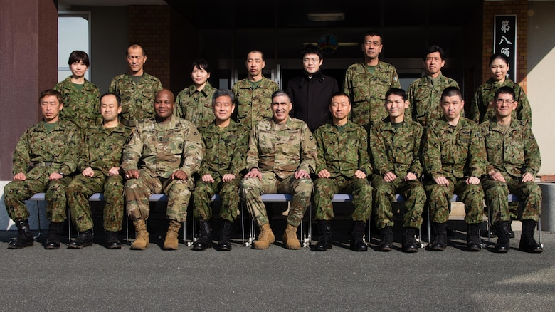 Senior leaders from the Army Reserve Engagement Team-Japan (ARET-J) and the Reserve Component from Western Army, Japan Ground Self Defense Force (JGSDF), pose for a group photo at JGSDF Western Army headquarters in Camp Kenjun, Japan, Jan. 16, 2016. U.S. Army Col. Luis Pomales (first row, center), a San Juan, Puerto Rico, native serving as the director of the Army Reserve Engagement Team-Japan (ARET-J), and U.S. Army Sgt. Maj. Bennie B. Nunnally (first row, third from left), an Atlanta, Georgia, native serving as the senior enlisted advisor, ARET-J, visited Camp Kenjun to discuss ideas and share best practices to enhance the readiness of the U.S. Army Reserve and the JGSDF Reserve Component. (U.S. Army photo by Sgt. John L. Carkeet IV, U.S. Army Japan)
