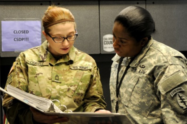 Army Master Sgt. Amber Chavez, left, the logistics noncommissioned officer in charge for 10th Special Forces Group (Airborne), mentors a junior soldier as she trains her in Army logistics at Fort Carson, Colo, Jan. 12, 2016. Chavez said she believes mentoring and training soldiers and possessing an inner drive to professionally improve every day are key components to success in the Army. U.S. Army photo by Staff Sgt. Jorden M. Weir