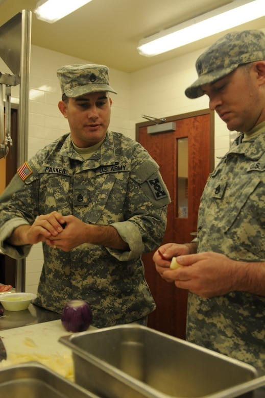 Staff Sgt. Joseph Parker, 451st Quartermaster Company and captain of the Army Reserve Culinary Arts Team, confers with Staff Sgt. Markos Mendoza, 257th Transportation Company and a member of the Army Reserve Culinary Arts Team, as they train for the 41st Annual Military Culinary Arts Competition.