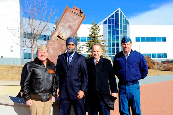 Admiral Bill Gortney, Commander of the North American Aerospace Defence Command (NORAD) and U.S. Northern Command (USNORTHCOM), together with, Defence Minister Harjit S. Sajjan, John Forster, Deputy Minister of National Defence, and Canadian Lieutenant-General Pierre St-Amand, Deputy Commander of NORAD, pose for a photo in front of the 9/11 memorial at NORAD headquarters in Colorado on January 20, 2016. Photo by Jhomil Bansil/released.
