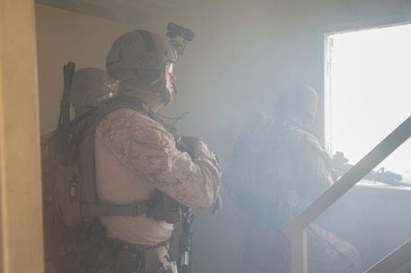 U.S. Marines and Sailors with the Maritime Raid Force, 13th Marine Expeditionary Unit, conduct a raid during their Sustainment Exercise at Fort Hunter Liggett, Calif., Jan. 17, 2016. SUSTEX is designed to reinforce the Boxer Amphibious Ready Group/MEU's execution of mission essential tasks in preparation for their upcoming deployment. (U.S. Marine Corps photo by Sgt. Tyler C. Gregory/released)