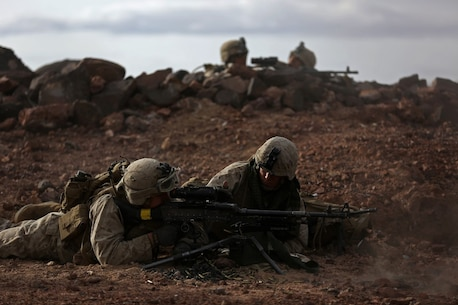 Marines assigned to Company B, 1st Battalion, 1st Marine Regiment, 1st Marine Division, fire on an objective during a company-level assault, as part of combined arms live-fire, Marine Rotational Force – Darwin exercise, aboard Marine Corps Air Ground Combat Training Center Twentynine Palms, Calif., Jan. 18, 2016. The Marines completed the training as part of their preparations for an upcoming deployment to Australia.