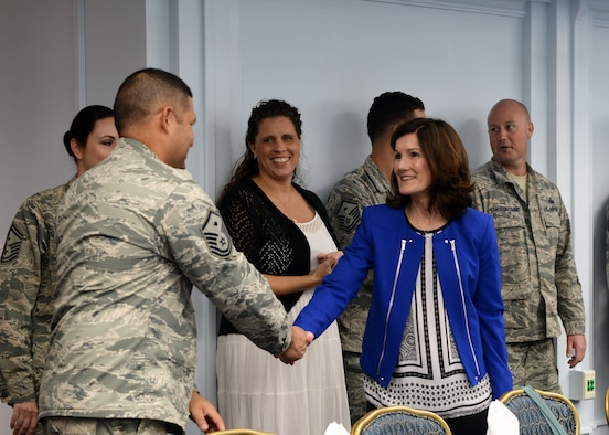 Betty Welsh, spouse of Air Force Chief of Staff Gen. Mark A. Welsh III, greets base leaders and spouses during a luncheon Jan. 21, 2016, at Andersen Air Force Base, Guam. Accompanying her husband on his visit to the base, Betty discussed the challenges spouses face and thanked them for supporting their partners. (U.S. Air Force photo/Senior Airman Cierra Presentado)