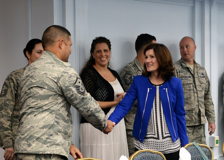 Betty Welsh, spouse of Air Force Chief of Staff Gen. Mark A. Welsh III, greets base leaders and spouses during a luncheon Jan. 21, 2016, at Andersen Air Force Base, Guam. Accompanying her husband on his visit to Andersen, Betty discussed the challenges spouses face and thanked them for supporting their partners. (U.S. Air Force photo/Senior Airman Cierra Presentado)