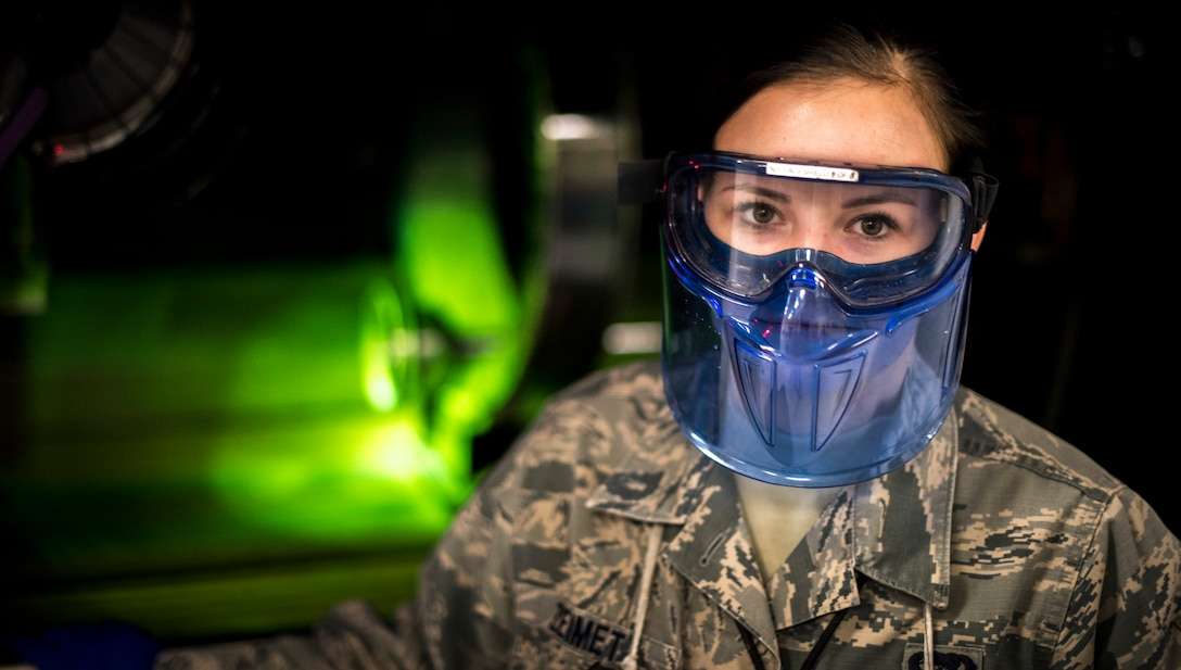 Senior Airman Violette Zeimet, 366th Equipment Maintenance Squadron non-destructive inspections journeyman, poses for a photo in front of one of the machines, Jan. 15, 2016, at Mountain Home Air Force Base, Idaho.  With different types of materials coming into the shop, NDI personnel must determine what test method to use and prepare fluids and parts for inspection.(U.S. Air Force photo by Senior Airman Jeremy L. Mosier/Released)