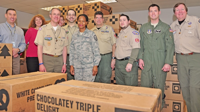 Members of the Boy Scouts of America from the Greater Niagara Frontier Council pose with members of the 914th Niagara Falls Airlift Wing at the Airman and Family Readiness Center on January 6, 2016. The groups worked together to unload a donation of more than 130 cases of Boy Scout popcorn. (U.S. Air Force photo by Staff Sgt. Richard Mekkri)