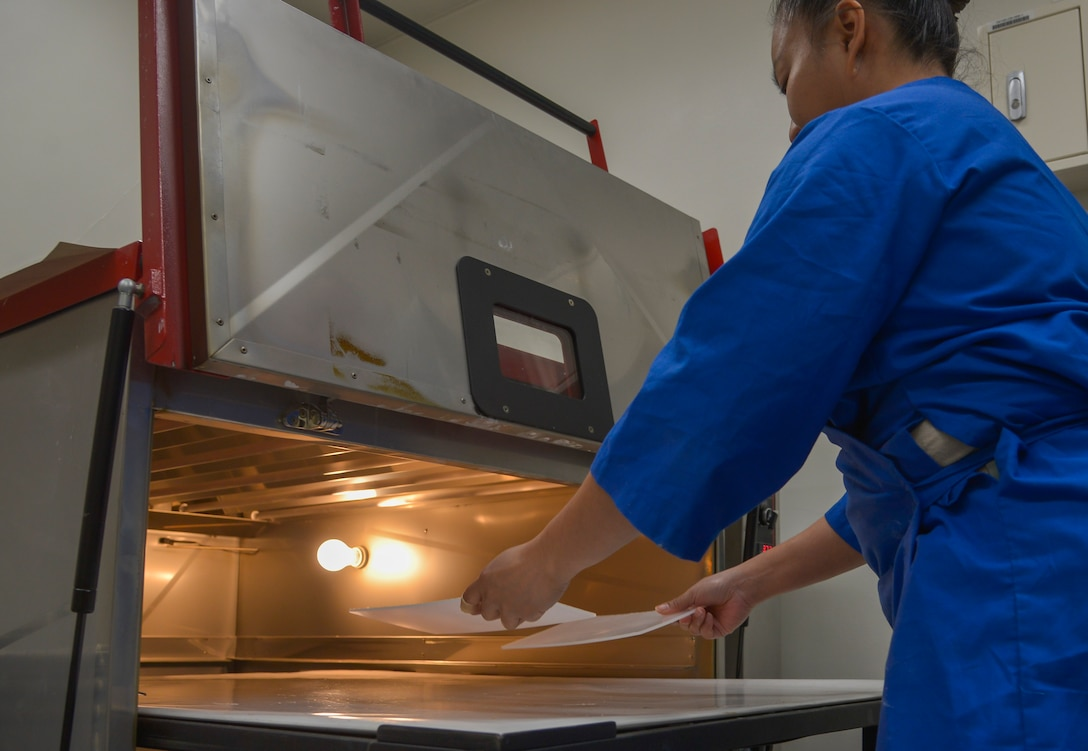 Tech. Sgt. Joy Victoria, 374th Surgical Operations Squadron orthotics NCO in charge, places polypropylene plastic in an oven at Yokota Air Base, Japan, Jan. 20, 2016. The plastic is molded to a person's foot and used for shoe inserts. (U.S. Air Force photo by Senior Airman David Owsianka/Released)