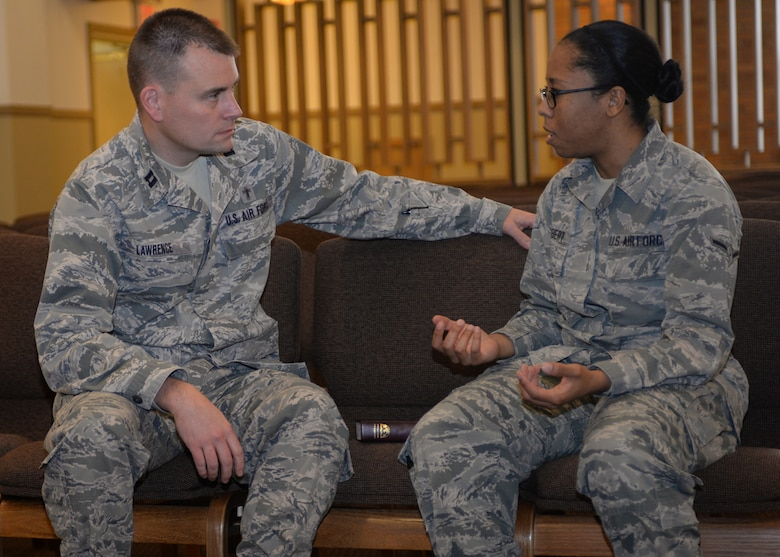 Chap. (Capt.) Greg Lawrence, 28th Bomb Wing chaplain, left, talks with Airman Sadie Colbert, 28th Bomb Wing photojournalist, at Ellsworth Air Force Base, S.D., Jan. 8, 2016. Personnel can use the chaplain corps to request confidential counseling, allowing Airmen to feel secure when discussing sensitive information. To contact the base Chapel Office, call (605) 385-1598. (U.S. Air Force photo by Airman Sadie Colbert/Released)