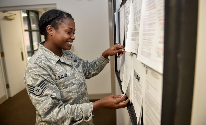 Staff Sgt. Torri Bagsby, 628th Air Base Wing chaplain assistant, updates the chapel's bulletin board  Jan. 8, 2016 at Joint Base Charleston, S.C. The Joint Base Charleston Inspection Program is part of the Air Force Inspection System and falls under the Air Mobility Command's Inspection Program. In April, a team of inspectors from AMC will be assessing our program in person. (U.S. Air Force Photo/Staff Sgt. Jared Trimarchi)