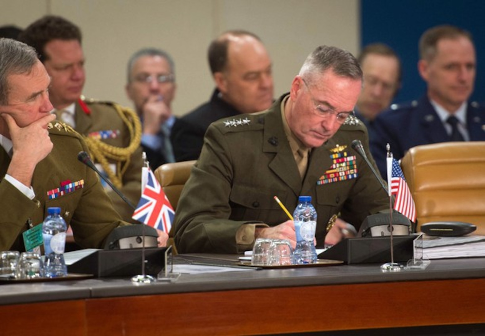 U.S. Marine Corps Gen. Joseph F. Dunford Jr., chairman of the Joint Chiefs of Staff, takes notes during a meeting at NATO headquarters in Brussels, Jan. 21, 2016. (DoD photo by D. Myles Cullen)