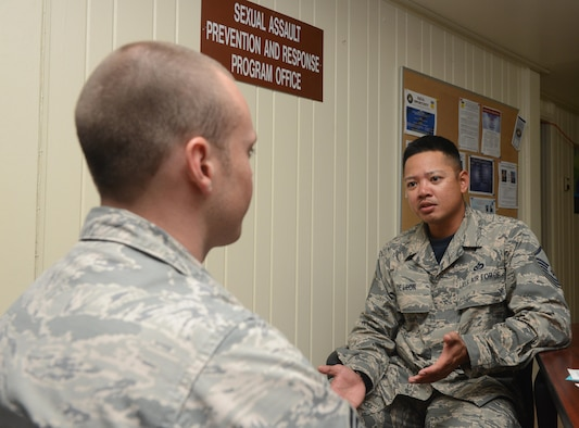 Master Sgt. Dan De Leon, 36th Civil Engineer Squadron NCO in charge of planning, who is also a part-time victim advocate, speaks to an Air Force member about Sexual Assault Prevention and Response program Jan. 20, 2016, on Andersen Air Force Base, Guam. Victim advocates are trained to respond as support for sexual assault victims, helping them through the investigation and providing resources to assist them in making informed decisions about their case. (U.S. Air Force photo/Airman 1st Class Arielle Vasquez)