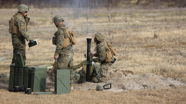 Marines with 2nd Battalion, 2nd Marine Regiment,  launch  a round during a live-fire mortar exercise with 81 mm mortar systems in preparation for the unit's upcoming deployment at Marine Corps Base Camp Lejeune, North Carolina, Jan. 21,2016. The Marines worked with the mortar systems until the late evening, sending more than 350 rounds downrange, and accomplished their goal of having more than 90 percent of their rounds impact on their designated targets.