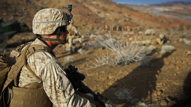 A Marine squad leader assigned to Company C, 1st Battalion, 1st Marine Regiment, 1st Marine Division, provides security during a company-level assault, as part of combined arms live-fire, Marine Rotational Force – Darwin exercise, aboard Marine Corps Air Ground Combat Training Center Twentynine Palms, California, Jan. 18, 2016. Infantry squad leaders holding the rank of corporal or sergeant  can apply now for the recently updated Squad Leader Development Program, and earn the new military occupational specialty of 0365 - Infantry Squad Leader if selected from the pool of applicants.