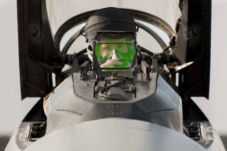 "First Lt. Matthew Sanders, a 421st Expeditionary Fighter Squadron pilot, prepares for a combat sortie in an F-16 Fighting Falcon at Bagram Airfield, Afghanistan, Jan. 17, 2016. Airmen assigned to the 421st EFS, known as the ""Black Widows,"" are deployed from Hill Air Force Base, Utah, in support of Operation Freedom's Sentinel and NATO's Resolute Support missions. (U.S. Air Force photo/Tech. Sgt. Robert Cloys)"
