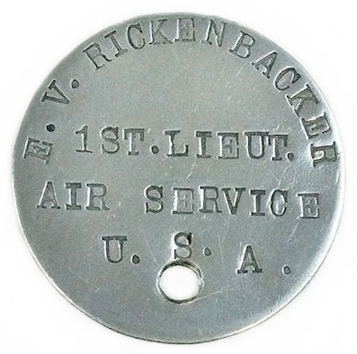 "Commander of the ""Hat-in-Ring"" 94th Aero Squadron, Capt. Edward V. Rickenbacker was a World War I American fighter ace. He had the most aerial victories of all American fighter pilots during the war with 26. His dog tag shown here was issued to him as a First Lieutenant. It reads: E.V. RICKENBACKER, 1ST. LIEUT., AIR SERVICE, U.S.A. (U.S. Air Force photo)"