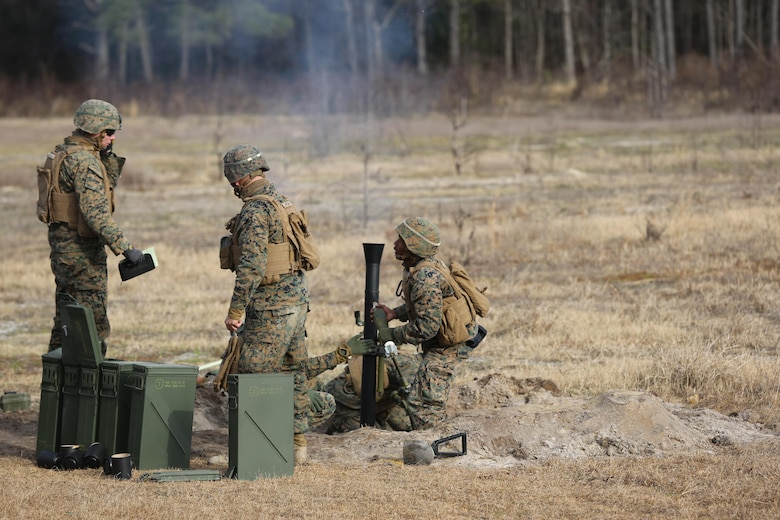 Marines with 2nd Battalion, 2nd Marine Regiment,  launch  a round during a live-fire mortar exercise with 81 mm mortar systems in preparation for the unit's upcoming deployment at Camp Lejeune, N.C., Jan. 21. The Marines worked with the mortar systems until the late evening, sending more than 350 rounds downrange, and accomplished their goal of having more than 90 percent of their rounds impact on their designated targets. (U.S. Marine Corps photo by Cpl. Shannon Kroening/ Released)