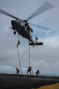 U.S. Marines with Fox Company, 2nd Battalion, 1st Marine Regiment and the Maritime Raid Force with the 13th Marine Expeditionary Unit, fast rope from a CH-60 Seahawk with Helicopter Sea Combat Squadron 23 aboard the USS Boxer off the coast of southern California during their Sustainment Exercise January 17, 2016. SUSTEX is designed to reinforce the Boxer Amphibious Ready Group/MEU's execution of mission essential tasks in preparation for their upcoming deployment. (U.S. Marine Corps photo by Sgt. Tyler C. Gregory/released)