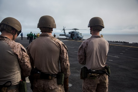 U.S. Marines with Fox Company, 2nd Battalion, 1st Marine Regiment and the Maritime Raid Force with the 13th Marine Expeditionary Unit, prepare to fast rope from a CH-60 Seahawk with Helicopter Sea Combat Squadron 23 aboard the USS Boxer off the coast of southern California during their Sustainment Exercise Jan. 17, 2016. SUSTEX is designed to reinforce the Boxer Amphibious Ready Group/MEU's execution of mission essential tasks in preparation for their upcoming deployment. (U.S. Marine Corps photo by Sgt. Tyler C. Gregory/released)