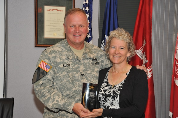 Lynn Daniels received an award July 20, 2015, from Col. Robert Ruch, U.S. Army Engineering and Support Center, Huntsville commander, recognizing her as the Huntsville Center Project Manager of the Year. Daniels, a virtual project manager from Seattle District, provides full-time support for the Huntsville Center's Facilities Reduction Program. In 2014, she managed projects on eight military installations from Georgia to Alaska, removing 2.8 million square feet of real property (217 facilities) for $22.7 million.