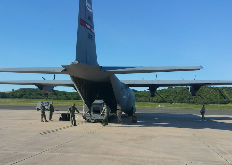 "Air Force reservists with the 403rd Wing, based at Keesler Air Force Base, Mississippi, load an 815th Airlift Squadron C-130J with equipment as part of the ""Roll Up"" Jan. 10-17, 2016 at the Henry Rohlsen Airport in St. Croix, U.S. Virgin Islands. The airport is the forward operating base for the 53rd Weather Reconnaissance Squadron ""Hurricane Hunters."" (U.S. Air Force photo/Master Sgt. Brian J. Lamar)"