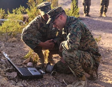 Staff Sgt. Ian Swain (left) and Staff Sgt. Joseph Witte (right), explosive ordnance disposal technicians with Headquarters and Headquarters Squadron, based out of Marine Corps Air Station Yuma, analyze an X-ray of an improvised explosive device during a training exercise at the Barry M. Goldwater Range in Yuma, Ariz., Tuesday, Dec. 8, 2015.