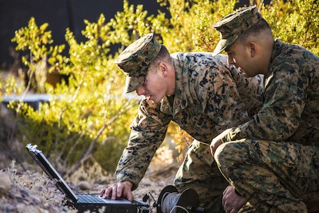 Sgt. Andrew Barnum (left) and Staff Sgt. Danny Salazar (right), explosive ordnance disposal technicians with Headquarters and Headquarters Squadron, based out of Marine Corps Air Station Yuma, analyze an X-ray of an improvised explosive device during a training exercise at the Barry M. Goldwater Range in Yuma, Ariz., Tuesday, Dec. 8, 2015.