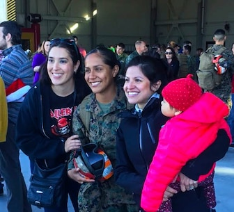 Sgt. Jessica Villanueva, an ordnance Marine with Marine Attack Squadron 311, based out of Marine Corps Air Station Yuma, reunites with her family at the VMA-311 hanger aboard MCAS Yuma, Ariz. Sunday, Dec. 11 2015. VMA-311 was on a six-month deployment in support of the 15th Marine Expeditionary Unit.