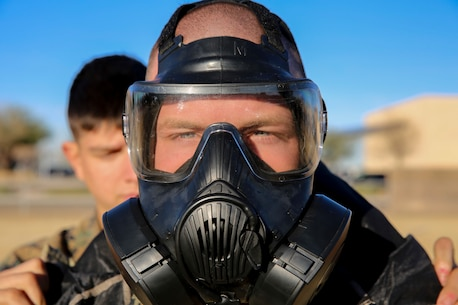 Pfc. Jarett Houk, a motor transport mechanic with Marine Wing Support Squadron 371 and a native of Virginia Beach, Va., gears up to begin Chemical, Biological, Radiological and Nuclear (CBRN) decontamination and reconnaissance training aboard Marine Corps Air Station Yuma, Ariz., Jan. 13, 2016.
